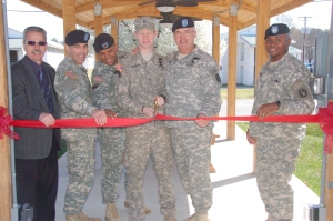 Fort A.P. Hill celebrates Post Exchange improvements with a ribbon cutting ceremony today. From left to right: Richard Talbot of Army and Air Force Exchange Service, Lt. Col. John W. Haefner, Fort A.P. Hill garrison commander; Command Sgt. Maj. Miguel E. Reyna, Fort A.P. Hill garrison command sergeant major; Staff Sgt. Benjamin Spitler; Maj. Gen. Karl R. Horst, Joint Force Headquarters-National Capital Region and Military District of Washington commander; Command Sgt. Maj. Michael Williams, JFHQ-NCR and MDW command sergeant major; join to cut the ribbon.
