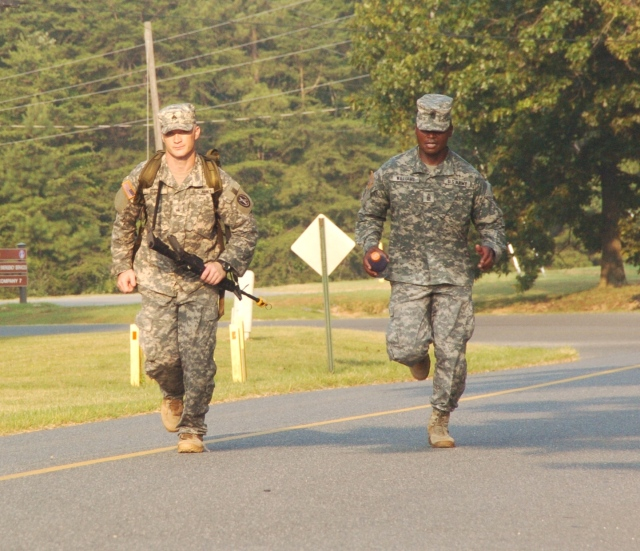 Command Sgt. Maj. Michael W. Williams (right), Command Sgt. Maj. of the Joint Force Headquarters National Capital Region and the U.S. Army Military District of Washington (JFHQNCR/MDW) runs with Sgt. Matthew Rossi