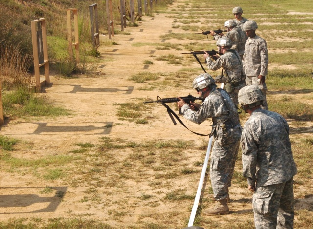 Standing in the middle of the firing line is Sgt. Joshua Blue, 1st Battalion BWC Cadre overseeing Soldiers conducting reflexive fire Jul. 20, Fort A.P. Hill.