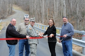 From left to right: Scott Kittle and Mike Earl of Fort A.P. Hill Directorate of Plans, Training, Mobilization, and Security; Fort A.P. Hill Garrison Commander Lt. Col. Jack Haefner; Jean Schofield, Fort A.P. Hill's Burma Road Bridge project contract officer's representative; and Ron Green, Fort A.P. Hill construction control representative; join to celebrate the successful replacement of Burma Road Bridge at a ribbon cutting ceremony Friday.