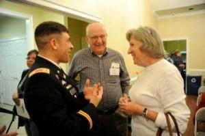 From left to right, Fort A.P. Hill Garrison Commander Lt. Col. Jack Haefner talks with Don and Peggy Lundry of the 55 Club of Lee's Hill following his presentation to the club about Fort A.P. Hill March 21 in Fredericksburg.