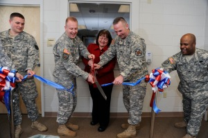 Fort A.P. Hill reopened its health clinic on March 18. Shown here cutting the ribbon from left are: Sgt. Christopher J. Watson, clinic noncommissioned officer, Col. Thomas S. Bundt, Kenner Army Health Clinic commander, Nurse Practitioner Carol Campbell, Lt. Col. Peter E. Dargle, Fort A.P. Hill commander and Sgt. Ramon Peguero, Wells Clinic noncommissioned officer in charge.