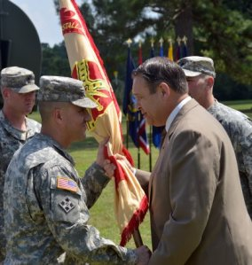 Lt. Col. David A. Meyer took command of U.S. Army Garrison Fort A.P. Hill during a Change of Command and Change of Responsibility Ceremony on June 27. Here Meyer (left) accepts the garrison colors from Mr. Davis D. Tindoll, Jr., director Installation Management Command Atlantic Region, signifying his assumption of command. Photo Credit: George Markfelder JFHQNCR MDW