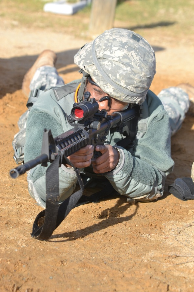 A Soldier gets familiar with the close combat optic before the start of the next phase of shooting