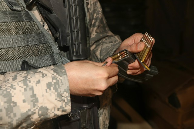 Spc. Arsham Orami fills his magazine clip during marksmanship competition training at Fort A.P. Hill, Va., from April 8-10, 2016. District of Columbia National Guard Soldiers completed strenuous training to prepare for the 45th Annual Winston P. Wilson Marksmanship Competition later this month in Arkansas. (U.S. Army National Guard photo by Sgt. Jennifer Amo/Released)