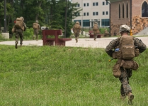 Marines with Fox Company, 2nd Battalion, 8th Marine Regiment run towards a simulated embassy building after exciting the MV-22 Osprey during embassy reinforcement training at the Asymmetric Warfare Training Center at Fort A.P. Hill, Va., June 28, 2016, as part of a certification exercise for the unit's upcoming deployment in support of Special-Purpose Marine Air-Ground Task Force, Crisis Response- Africa. During the training, the unit learned the most effective way to handle situations involving violent local citizens and what it feels like to interact with a combative local populace. (U.S. Marine Corps photo by Sgt. Michelle Reif/Released.)