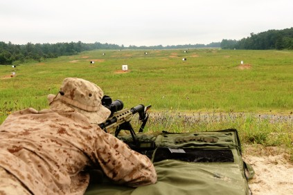 A Marine Sniper prepares to fire a .308 WinMag through a M40A6 rifle with a chronograph attached during a market research caliber study July 13, at Fort A.P. Hill, Virginia. Marine Corps Systems Command's Infantry Weapons Systems conducted the study to inform Marine Corps acquisition leaders about future Marine sniper weapon system requirements. (U.S. Marine Corps photo by Ashley Calingo)