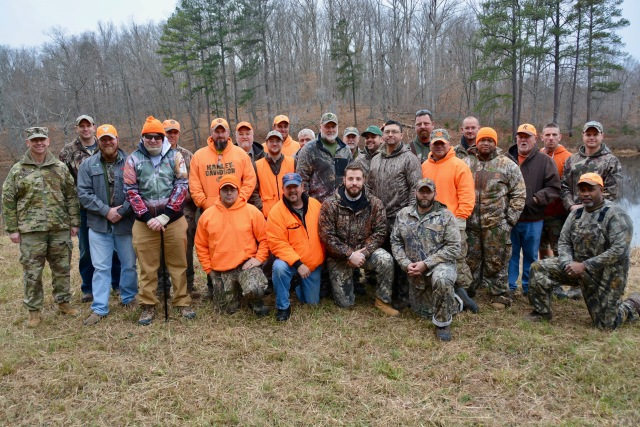 Soldiers from the Fort Belvoir Wounded Warrior stand with members of the A.P. Hill garrison after a successful deer hunt on the installation's expansive training grounds, Dec. 7 -- 10, 2017. (Photo Credit: Michael Meisberger (A.P. Hill))