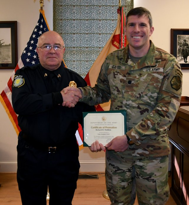 U.S. Army Garrison Fort A.P. Hill commander Lt. Col. Michael E. Gates (right) promoted Police Officer Richard D. Mullikin, Jr. (left) to Police Sergeant during a brief ceremony today in the garrison headquarters. Mullikin will serve as enforce conservation law as a game warden at A.P. Hill.
